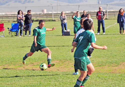 Down 2-0 at the half in their final tournament game of 2014, team captain Karina Briseño of the U-17 Real Salinas Thundergirls helps her side roar back to tie the game and retain first place.