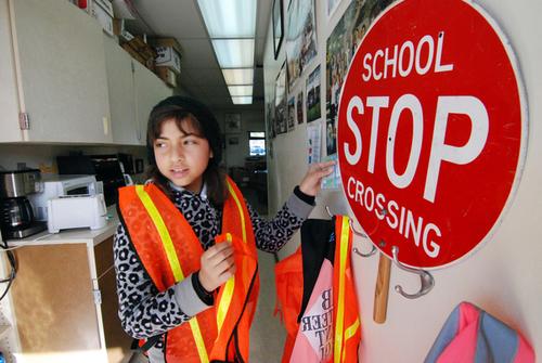 Peer mediator Esmeralda Macias stops by the team's ready station to pick up her conflict resolution materials at Virginia Rocca Barton Elementary School in Salinas.