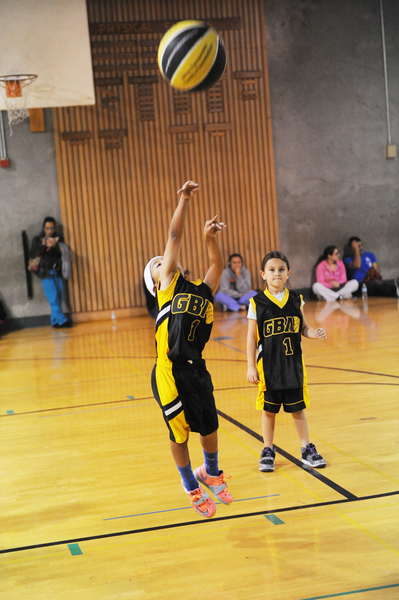 Taking a jump shot like a pro with a full-size ball, this young player will develop fast.