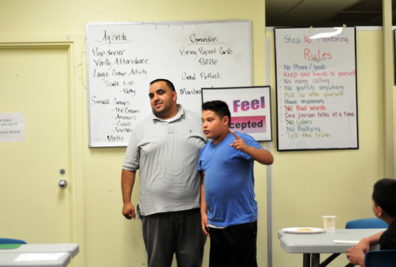 Mentor Leo Jimenez and Manny Morfin participate in a confidence exercise at the Silver Star Resource Center in Salinas.