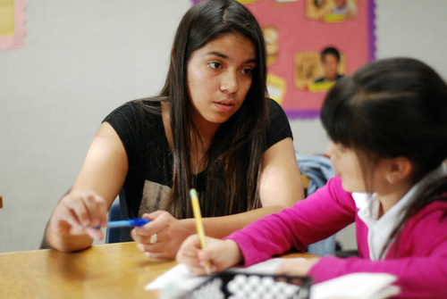 Tutor Mariana Garcia, left, works with student Miranda Escobar on her homework at the Los Padres Learning Center in Salinas.