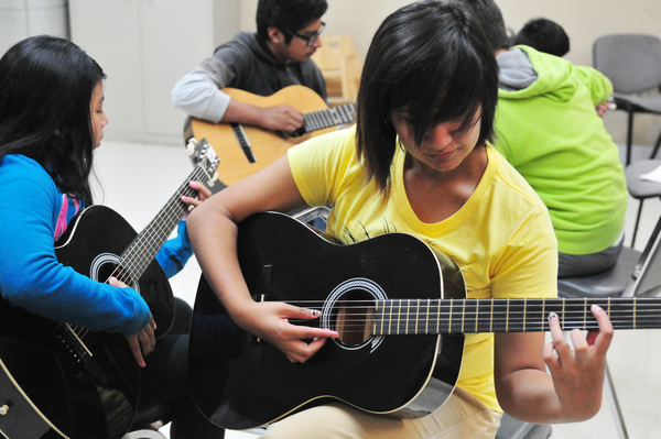 Rosa Rondin, 15, practices at Felix Miranda's open guitar class at CHISPA's Roosevelt Townhomes in Salinas.