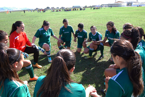 The U-17 Real Salinas Thundergirls say a prayer together before their final tournament game of 2014 versus San Bruno at Bolsa Knolls Middle School in Salinas.
